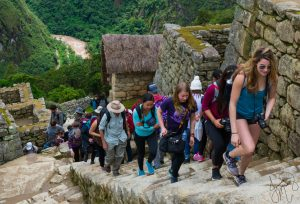 students climbing stone steps--MATH 25 Introductory Photography: Places and People in Peru (WS 2018 travel course)