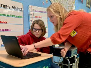 two students looking at laptop--CSCI 11 Hour of Cod (WS 2019)