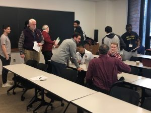 students collaborating in a classroom--ECON 10 A Practitioner's Overview of Securities Markets and Investment Banking (WS 2019)