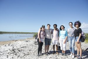 group photo on beach--MUS 25 Creative Art Projects inspired by Southern Florida Native American Indian History & Culture (WS 2019 travel)