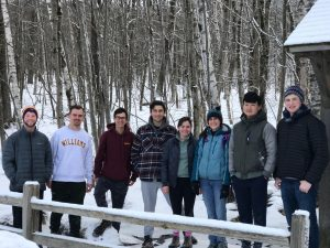 group photo in snow covered woods--REL 14 Mountain Religion (WS 2019)