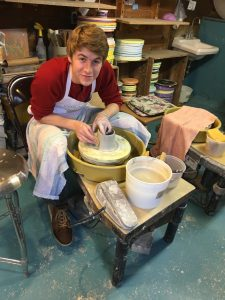 student using a potter's wheel--SPEC 35 Making Pottery on the Potter's Wheel (WS 2019)