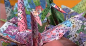 "colored origami paper with typing--WS 2018 ""Typewriters!"" course taught by Cassandra Cleghorn"